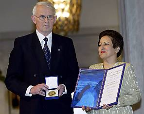 Iranian lawyer and human rights advocate Shirin Ebadi receiving the Nobel Peace Prize from committee leader Ole Danbolt Mjoes at the ceremony in Oslo's City Hall.